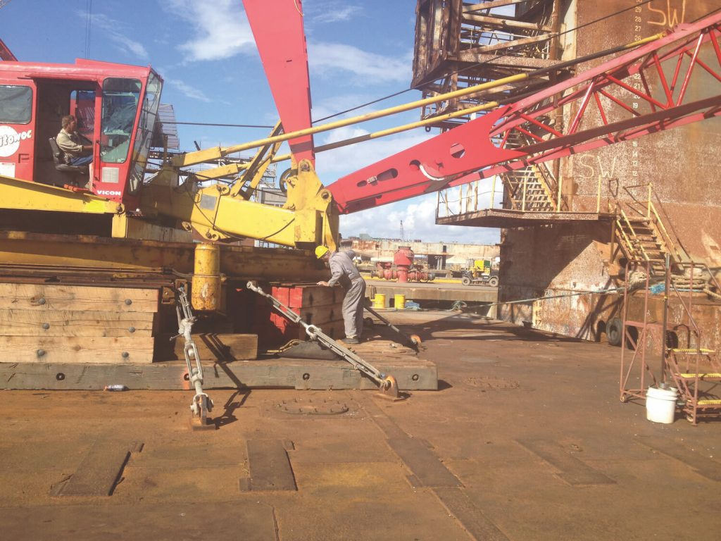 crane testing. Inspecting for deficiencies and correct assembly. Photo by Dennis O'Rourke