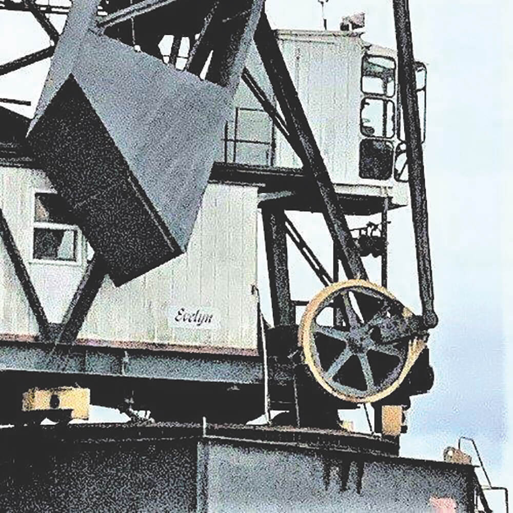 Counterweight on boom heel reduces luffing force.
